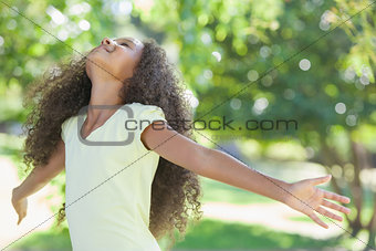 Young girl smiling with arms outstretched