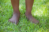 Little boys legs standing on grass