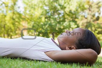 Little girl lying on the grass smiling