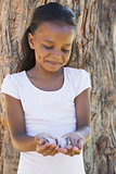 Little girl holding a butterfly in the park