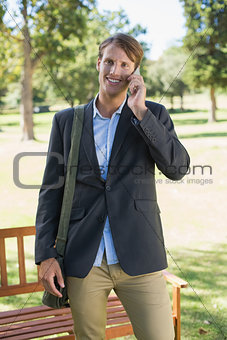 Casual businessman talking on smartphone in park