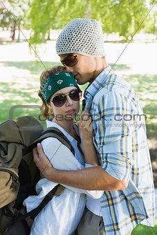 Active couple embracing each other on a hike