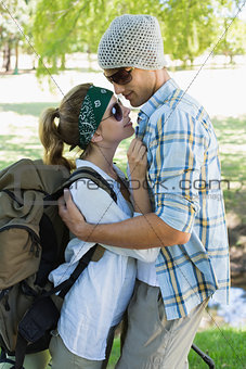 Active cute couple embracing each other on a hike