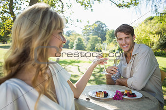 Cute blonde toasting with her smiling boyfriend