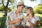Cute couple drinking white wine together outside