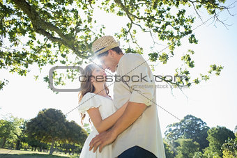 Cute couple standing in the park embracing