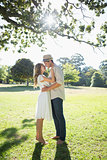 Attractive couple standing and embracing in park