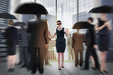 Composite image of redhead businesswoman in a blindfold