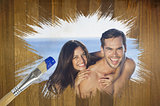 Composite image of attractive couple at the beach
