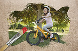Composite image of little girl on a bike