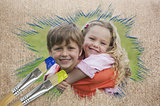 Composite image of sibling smiling in the park