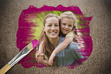 Composite image of mother and daughter with paintbrush dipped in pink paint