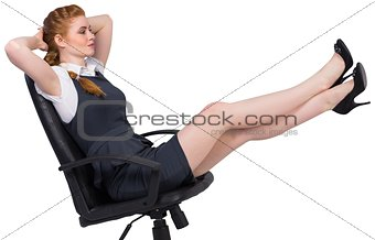 Businesswoman sitting on swivel chair
