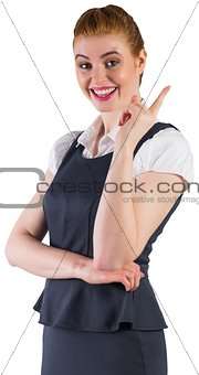 Redhead businesswoman pointing and smiling