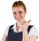 Redhead businesswoman showing thumbs up