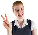 Redhead businesswoman showing peace sign