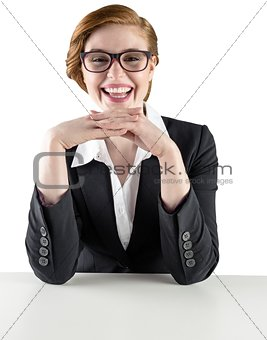 Redhead businesswoman sitting at desk