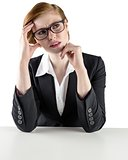 Thinking redhead businesswoman looking puzzled