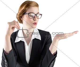 Businesswoman holding hand out in presentation
