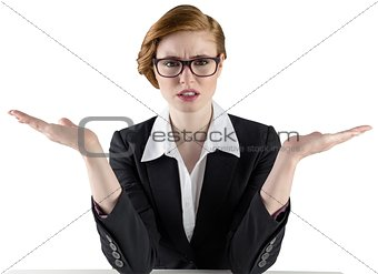 Businesswoman holding hands out in presentation