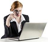 Redhead businesswoman using her laptop