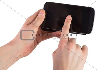 Hands holding smartphone showing screen