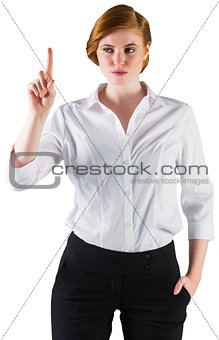Businesswoman standing and pointing