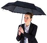 Businesswoman holding a black umbrella
