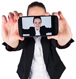 Businesswoman taking a selfie on smartphone