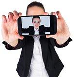 Businesswoman taking a selfie on smartphone