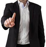 Businessman in suit standing and pointing