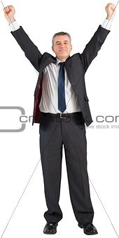 Mature businessman cheering with arms up