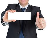 Mature businessman showing blank card