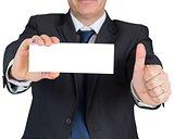 Mature businessman showing blank card