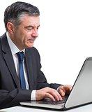 Mature businessman using his laptop