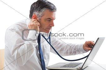 Mature businessman running diagnostics