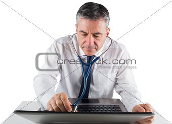Mature businessman running diagnostics on laptop