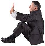 Mature businessman sitting and pushing