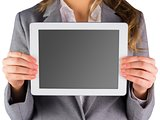 Businesswoman showing a tablet pc