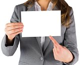 Businesswoman showing a blank card