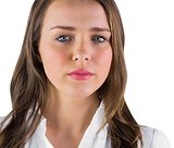 Serious young woman in white shirt