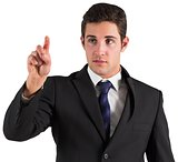 Young businessman standing and pointing