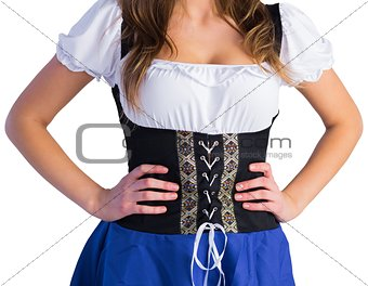 Oktoberfest girl standing with hands on hips