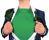 Businessman opening shirt in superhero style