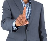 Focused businessman pointing
