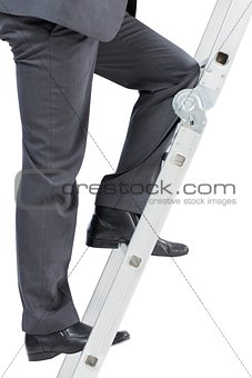 Businessman climbing up ladder
