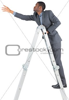 Businessman climbing up ladder