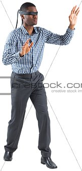 Blindfolded businessman with arms out