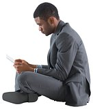 Businessman sitting and holding tablet