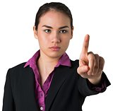 Serious businesswoman pointing